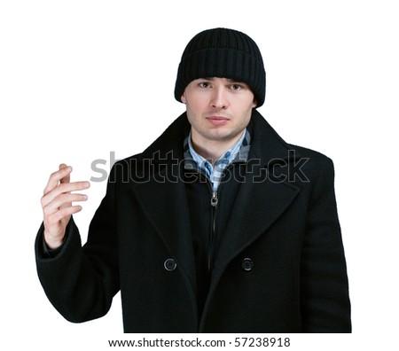 portrait of gloomy man in black coat - stock photo