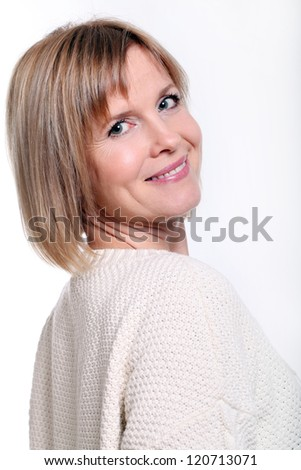 Portrait of good looking mid aged woman over a white background