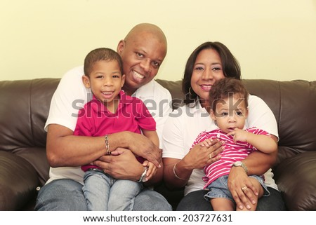 Portrait of gorgeous african family. Focus on the mother and the baby - stock photo