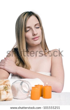 Portrait of gorgeous blond wellness girl with spa accessories. - stock photo