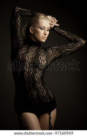 Portrait of gorgeous blond woman wearing dress  of transparent lace. Shallow depth of field - stock photo