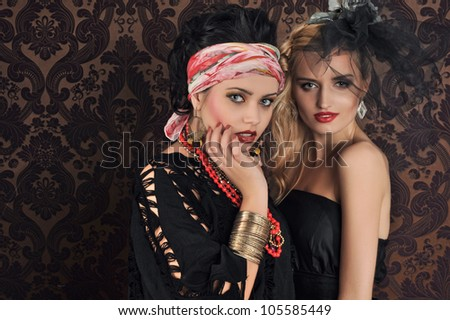 Portrait of gorgeous woman and beauty gypsy - stock photo