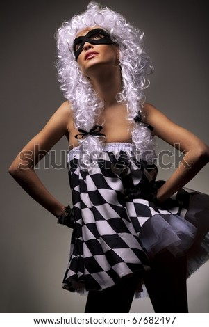 Portrait of gorgeous woman in chess Queen suit and in ancient style wig - stock photo