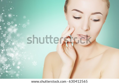 portrait of gorgeous woman over christmas background with snowflakes