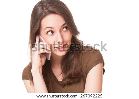 Portrait of gorgeous young brunette woman on the phone. - stock photo