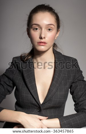 Portrait of gorgeous young caucasian attractive sexy business woman or secretary wearing checked jacket - stock photo