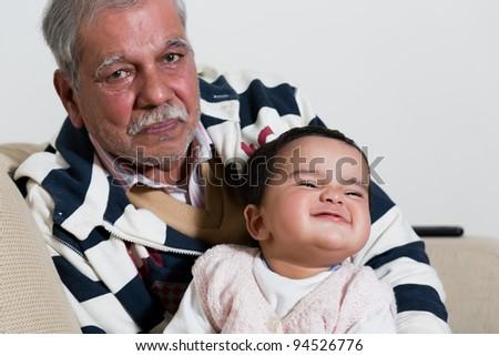 portrait of grandfather and grand daughter, grandfather and grandchild - stock photo