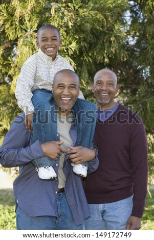 Portrait of grandfather, father and son