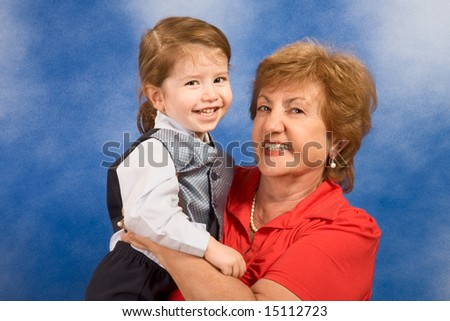 Portrait of grandmother holding two year old boy smiling and happy
