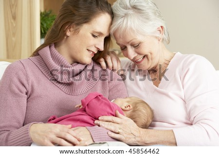 Portrait Of Grandmother, Mother And Daughter At Home - stock photo