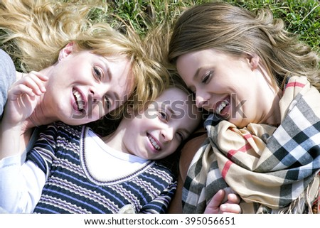 Portrait Of Grandmother With Daughter And Granddaughter  - stock photo