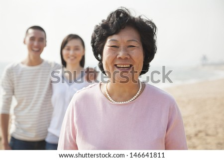 Portrait of Grandmother with Young Couple