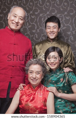 Portrait of grandparents and adult grandchildren in traditional Chinese clothing