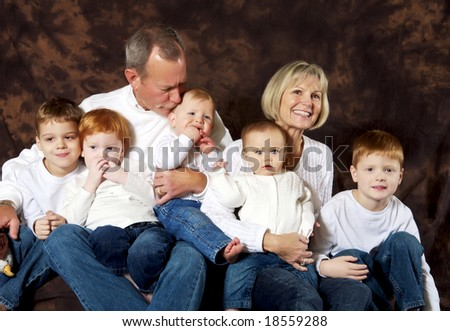 Portrait of grandparents and grandchildren hanging out together - stock photo