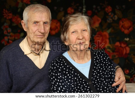 portrait of grandparents at the rural home  - stock photo