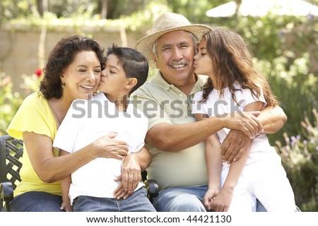 Portrait Of Grandparents With Grandchildren In Park - stock photo