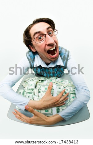 Portrait of greedy male raking in dollars and being glad - stock photo