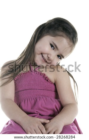 Portrait of grinning girl five years old tilting her head