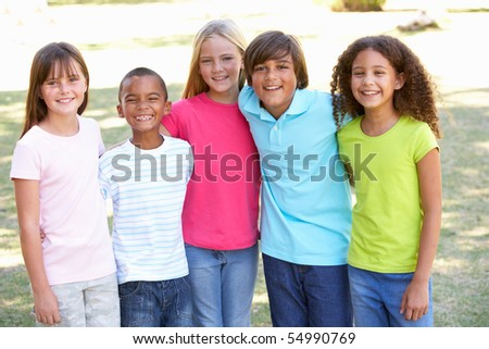 Portrait Of Group Of Children Playing In Park - stock photo