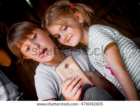 Portrait of group of children taking a selfie