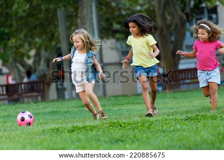 Portrait of group of childrens having fun in the park. - stock photo