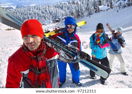 Portrait of group of skiers standing on ski slope - stock photo