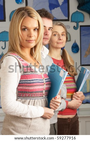 Portrait Of Group Of Teachers In Classroom - stock photo