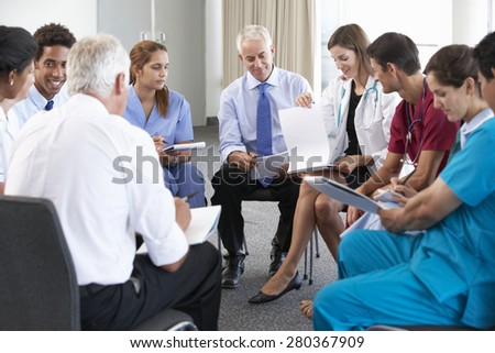 Portrait Of Group Of Workers In Medical Professions - stock photo
