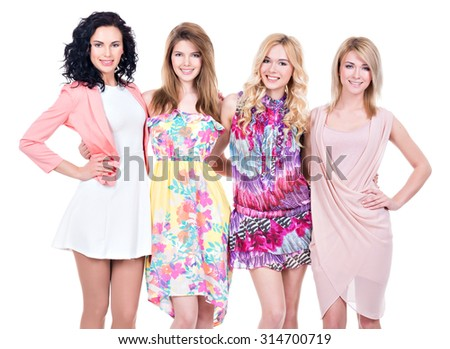 Portrait of group young beautiful smiling women in pink dresses - isolated on white. - stock photo