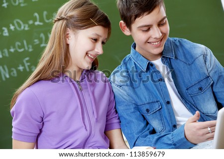 Portrait of guy and girl being busy during lesson - stock photo