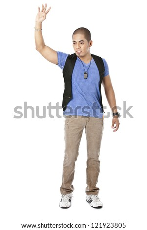 Portrait of guy standing while raising his hand against white background - stock photo