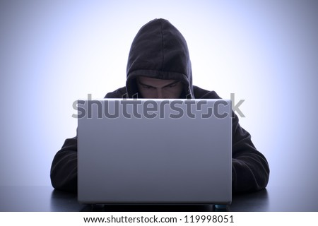 portrait of hacker and laptop meaning safety data - stock photo