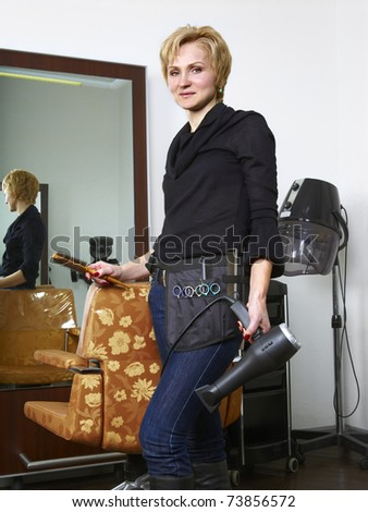 Portrait of  hairdresser at her work place - stock photo