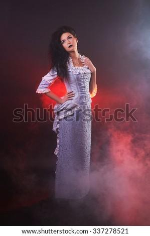 portrait of halloween vampire woman aristocrat with stage makeup - stock photo
