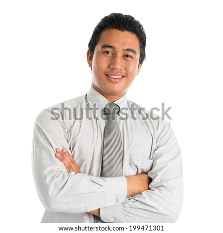 Portrait of handsome Asian young man in casual business attire, smiling confidently with arms crossed, standing isolated on white background. - stock photo