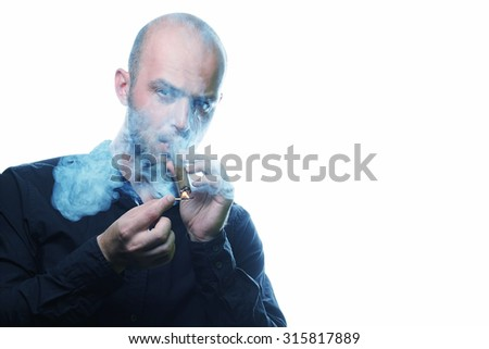 Portrait of handsome bald brutal young man in black shirt smoking cigar isolated on white - stock photo