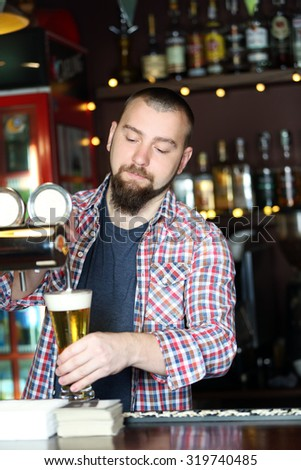 Portrait of handsome bartender at workplace - stock photo