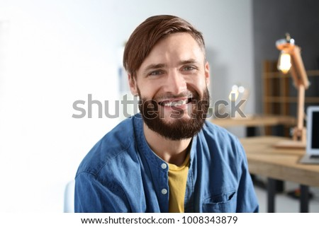 Portrait of handsome bearded man indoors
