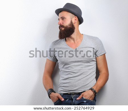 Portrait of handsome bearded man isolated on grey background - stock photo