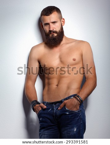 Portrait of handsome bearded man standing  isolated on grey  - stock photo