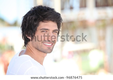 portrait of handsome black-haired man - stock photo
