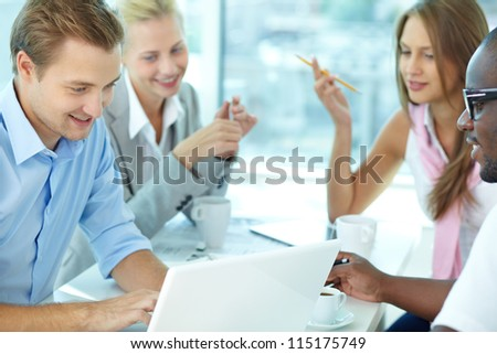 Portrait of handsome boss typing in working environment - stock photo