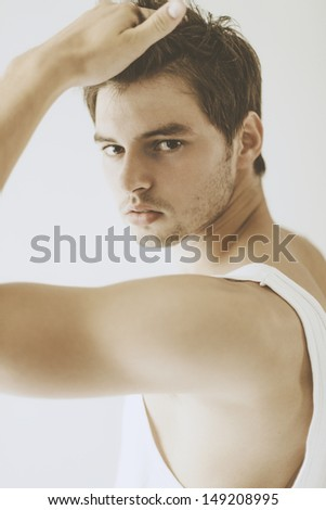 Portrait of handsome boy. Soft light, blur and strong grain added to create dreamy effect . Shallow depth of field.  - stock photo