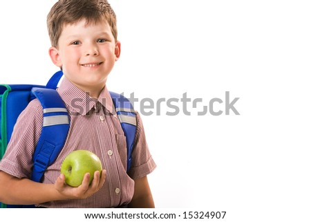 Portrait of handsome boy with a green apple isolated on a white background - stock photo