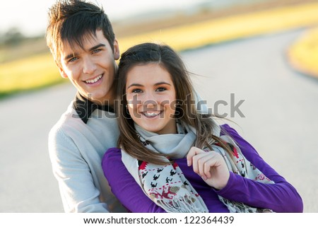 Portrait of handsome boy with girlfriend in countryside. - stock photo