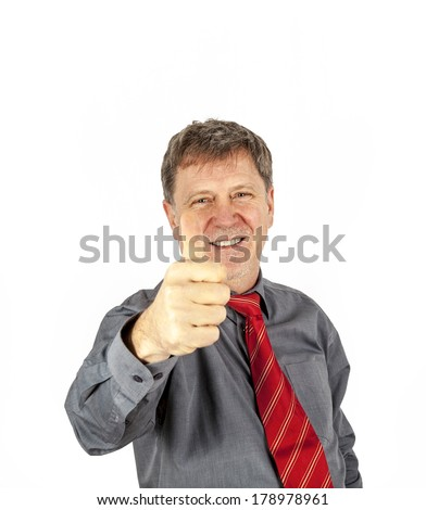 portrait of handsome business man with red tie showing thumbs up sign