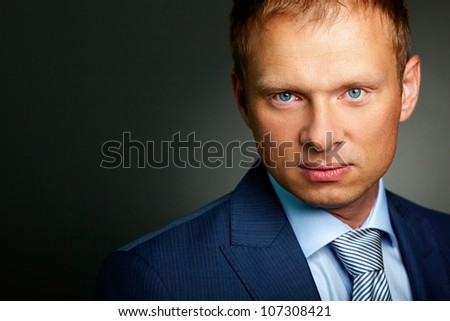 Portrait of handsome businessman looking at camera