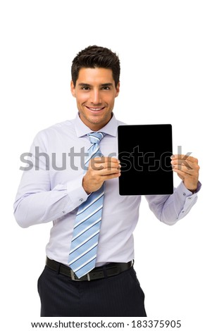 Portrait of handsome businessman promoting digital tablet isolated over white background. Vertical shot.