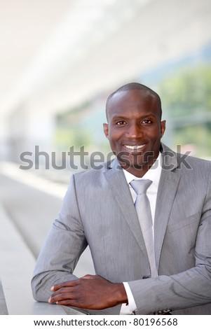 Portrait of handsome businessman wearing grey suit - stock photo