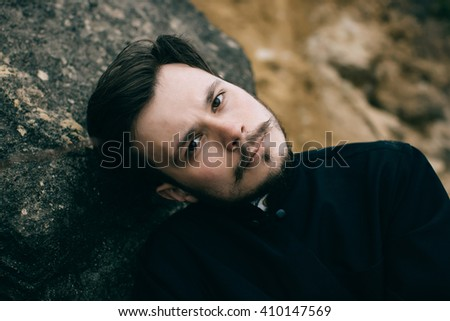 Portrait of handsome catholic bearded priest or pastor - stock photo